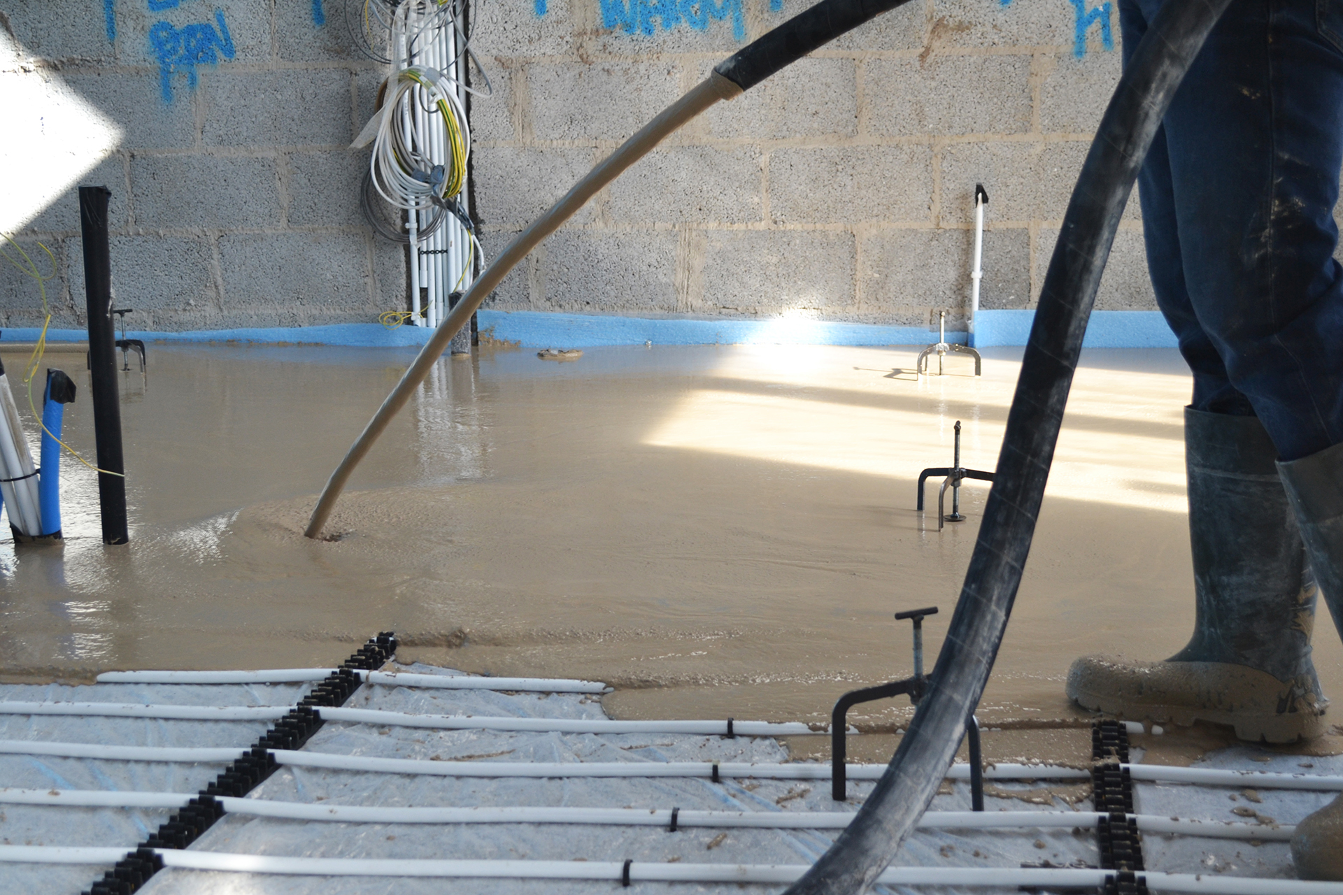 ADM Floor Screed Worker Pouring Liquid Screed